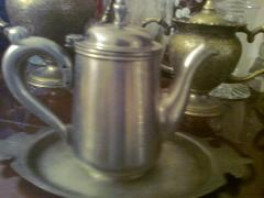 A beautiful kettle with a hinged lid.Retro